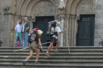 Pilgrims going up the stairway of the Plaza de las Praterías