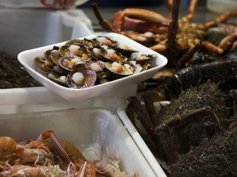 Seafood on display at Santiago's Mercado de Abastos. Photograph: Turismo de Santiago