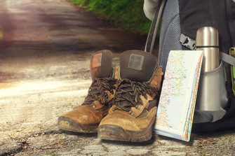Boots, map and backpack in a hostel