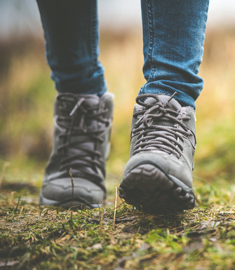Trekking or mountain boots are described as the most suitable for the Way