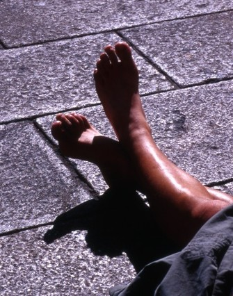 A pilgrim feet relaxed in a square in Santiago